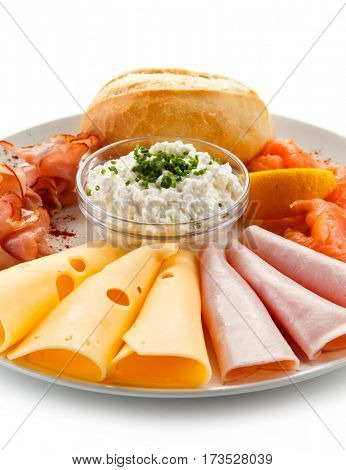 Breakfast - ham, smoked salmon, cheese, bread and vegetables