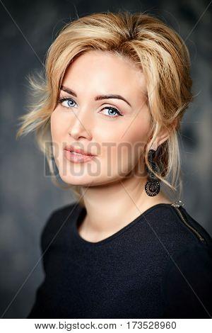 Close-up portrait of a beautiful middle-aged woman. Business woman portrait. Skincare, rejuvenation, cosmetics.