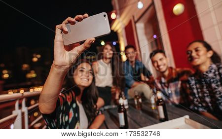 Young People Taking Self Portrait During Party