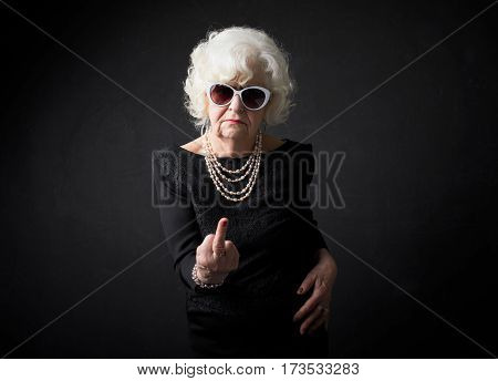 Grandmother flipping people off with middle finger