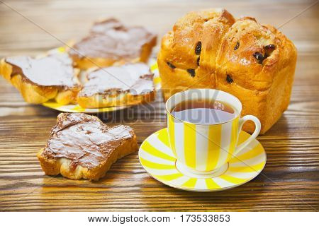 Delicious Tea With Bread And Chocolate Paste On Wooden