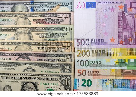Set Of American Dollars And Set Of Euros On Desk.