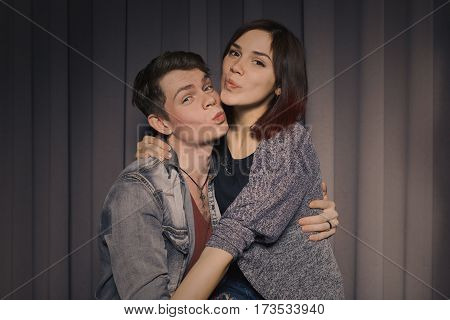 Happy couple in love in a photo booth
