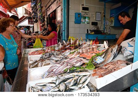 HERAKLION, CRETE - SEPTEMBER 19, 2016 - Fresh fish stall at the food market in the city centre Heraklion Crete Greece Europe, September 19, 2016.