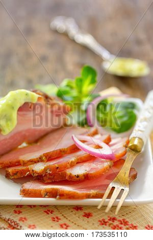smoked bacon and vegetables on wooden table