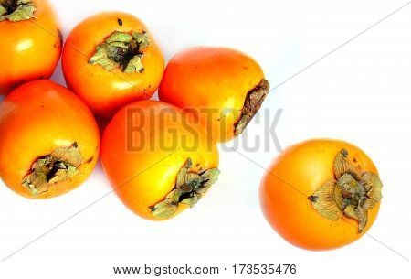 Still life with six ripe big persimmons isolated studio shot top view closeup