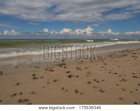 Sand beach and small stones on a shore of the Baltic Sea