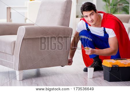 Superhero repairman with tools in repair concept
