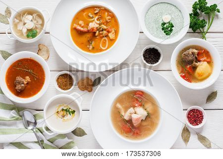 Assortment of hot soups flat lay. Top view on restaurant table with variety of warm fasting dishes on it. Buffet, menu, lunchtime, healthy food concept