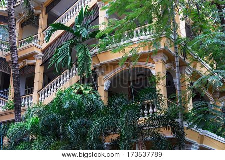 beautiful house with balconies and stairs