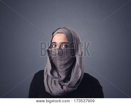 Young muslim woman wearing niqab
