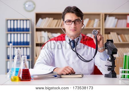 Superhero doctor working in the lab hospital