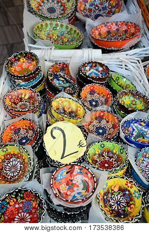 Traditional Cretan painted ceramic dishes for sale at a city centre shop along Odos 1821 Heraklion Crete Greece Europe.