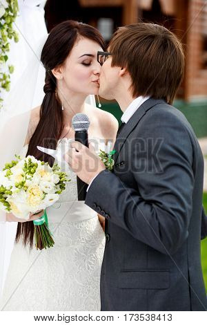 The very first kiss of newlyweds after they gave oathes