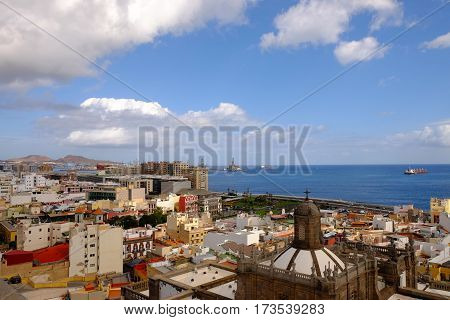 Aerial view on Las Palmas de Gran Canaria. Gran Canaria Spain - 13.02.2017. City landscape with colorful houses the tower of the Cathedral of Santa Ana the ships on the Atlantic ocean in a beautiful sunny day.