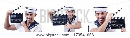 Sailor with movie clapper on white