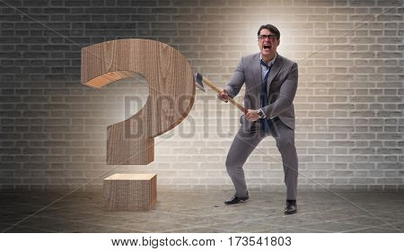 Angry man with axe axing the question mark