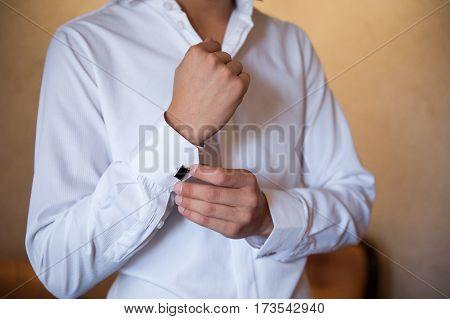 groom in a white shirt dress cufflinks.