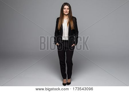 beautiful long haired fashion woman in dark gray business suit