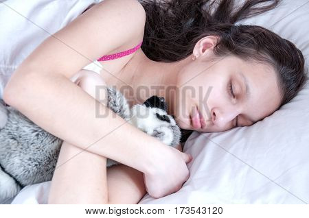 Teenager Girl Sleeping With A Soft Toy