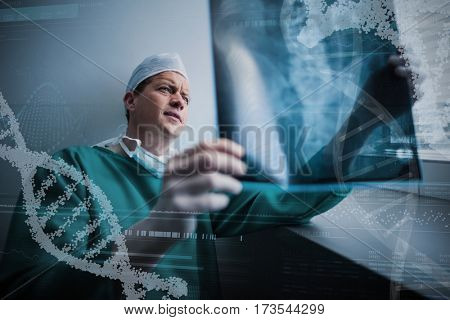 Panoramic view of helix pattern information on device screen against surgeon sitting at window and checking x-ray