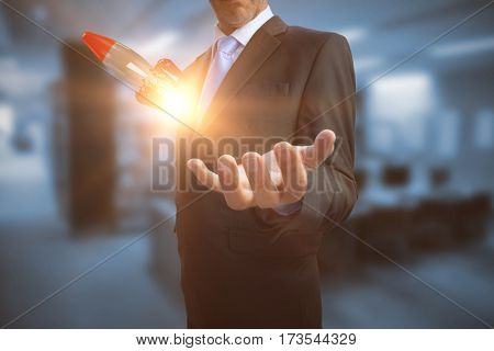 Businessman showing his empty hand against computer desks in the library 3D