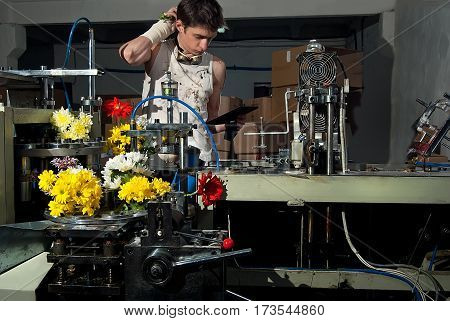 Flowers on the production of machines at the factory with the control engineer