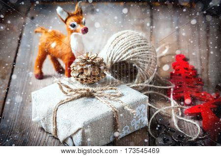 Gift Box Wrapped Linen Cloth And Decorated With Cord, Jute, Christmas Decoration. Drawn Snowfall