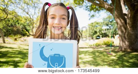 Print against portrait of young girl holding digital tablet