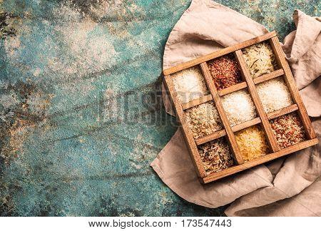 Varieties of rice in printers box, jasmine, wild, white, pearl, forbidden, jade, basmati and barley Top view