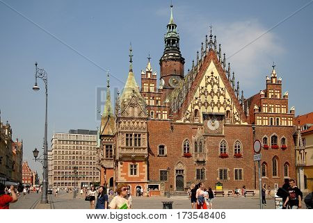 Wroclaw Poland - July 17 2014: Old Town Hall on the Market Square. Town Hall built in Gothic style of architecture is one of the main landmarks and tourist attractions in the city