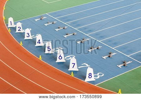 Start line with starting blocks for sprint running on track an field venue