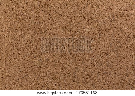 Cork board background texture brown color close.