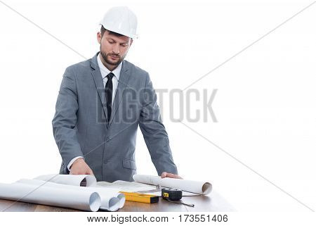 Project upgrade. Monochrome shot of a handsome mature male professional architect working on his building project copyspace isolated on white profession developer industry business building concept