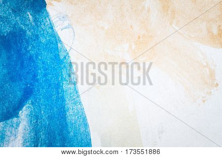 Macro shot of abstract hand drawn blue and brown watercolor paints background