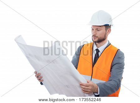 Going through details. Serious mature businessman architect on white background wearing hardhat and fluorescent safety vest copyspace builder contractor constructionist engineer developer professional