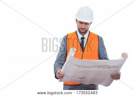 Business under construction. Professional male constructionist in a safety vest and helmet working on a building project isolated on white copyspace professionalism profession businesspeople concept
