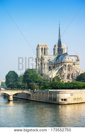 View of southern facade of Notre Dame de Paris from the Seine river. Notre Dame cathedral is a medieval catholic cathedral and finest example of french gothic architecture. Paris France.