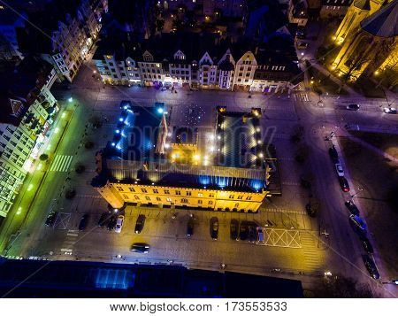 Aerial night view of the City Hall in an old town of Kolobrzeg in Poland winter time