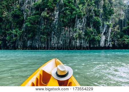 Kayak in the island lagoon between mountains. Kayaking in El Nido, Palawan, Philippines.