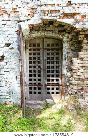 vintage door lattice in the ruined castle wall