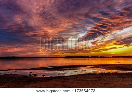 A colorful sunset over an Oklahoma lake.