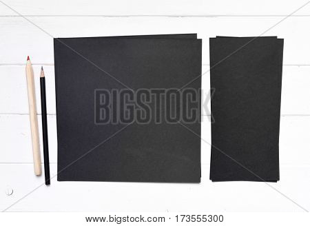 set of black paper different sizes with pencil
