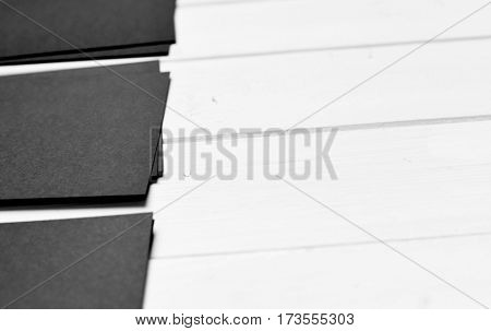 stack of black paper on a white table