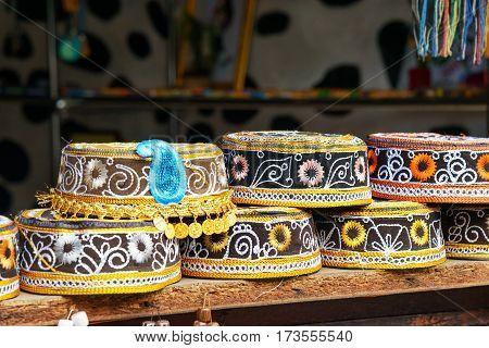 Taqiyah rounded skullcap. Traditional muslim hats sold on a local market. Sheki Azerbaijan