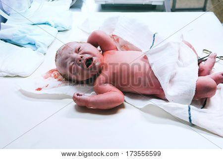 Newborn In Nursery After Childbirth.