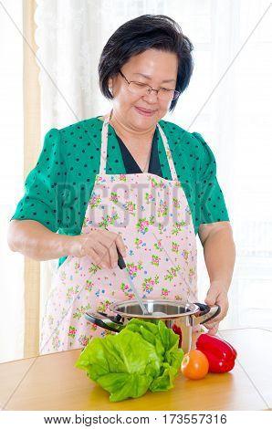 Asian senior woman enjoyed cooking at home