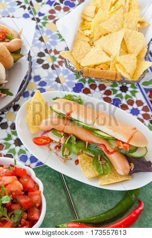 Fresh hot dogs with frankfurters and tortilla chips