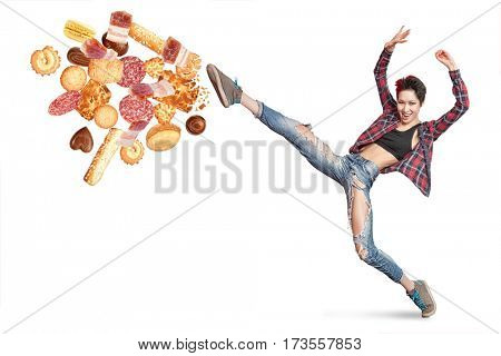 Fit young woman fighting off bad food isolation on a white background