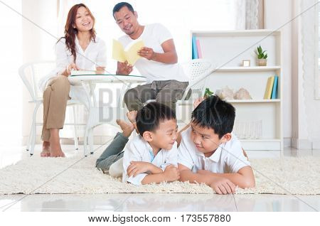 Asian family relaxed in the living room